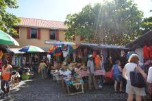 Tourists shop at the Craft Market in Roseau Dominica.jpg