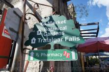 Attractions sign points to market Botanical Gardens and Trafalgar Falls in Roseau Dominica.jpg