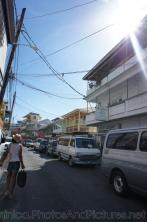 Vans and cars parked on street in downtown Roseau Dominica.jpg